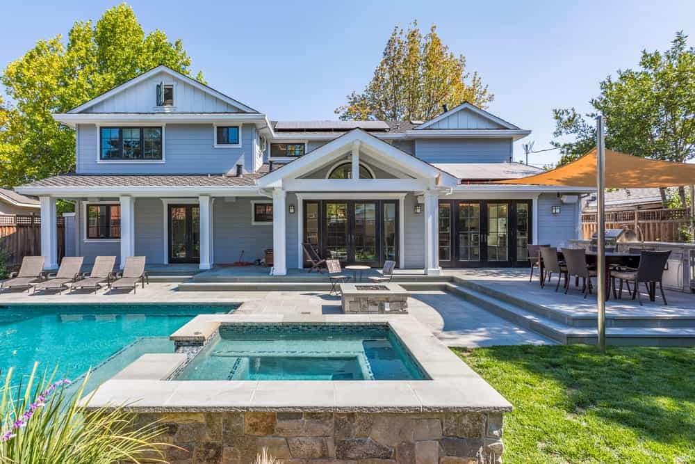 Beautiful home with a pool, hot tub and covered deck.